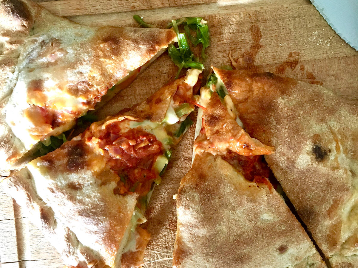 Spinach-Zucchini Calzone with Hot Tomato Sauce