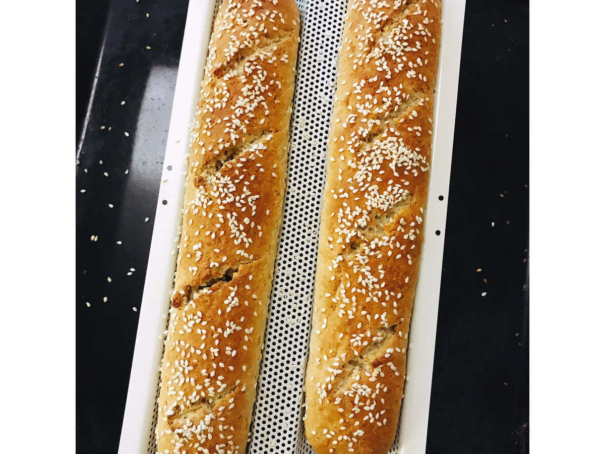 Brown coconut baguette with sesame