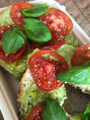 Bagels with avocado, tomato and basil