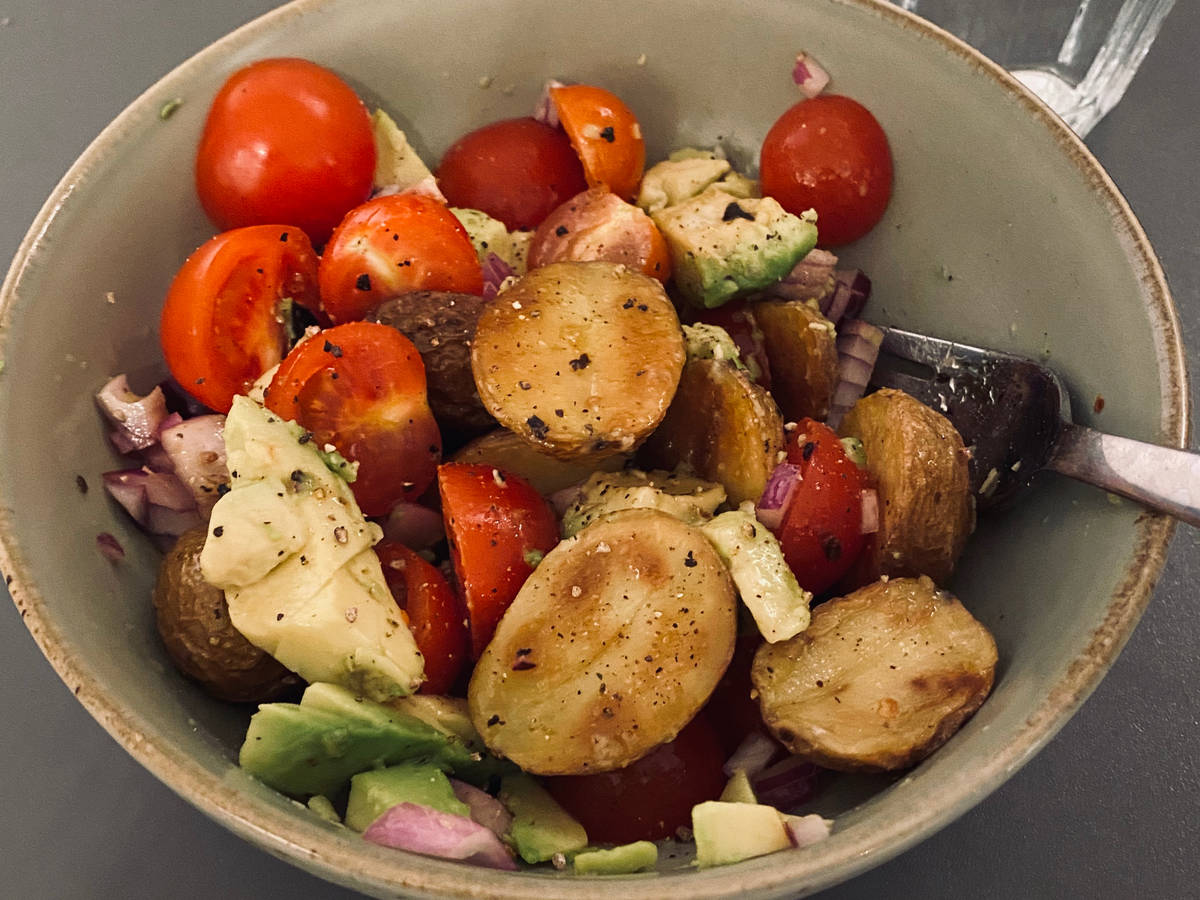 Simple potato salad with avocado and tomatoes