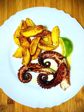 Octopus with baked potatoes