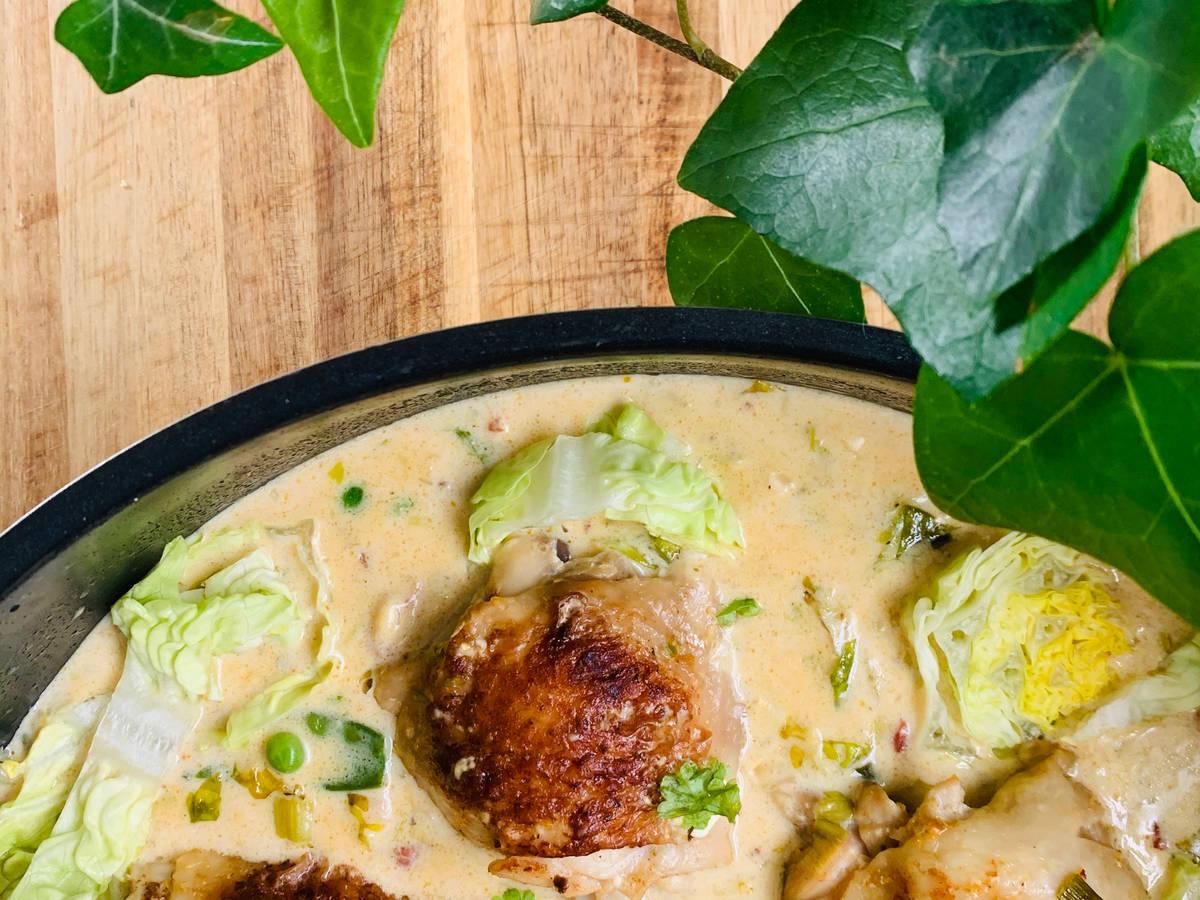 Chicken thighs in mustard cream sauce with vegetables