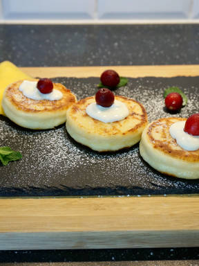 Syrniki or fried Eastern Slavic quark pancakes