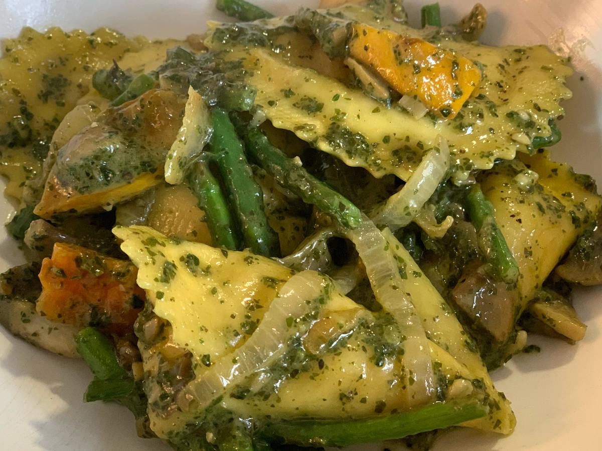 Truffle & parmesan ravioli with veggies and pesto