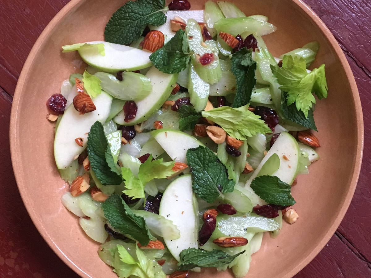 Crunchy celery salad with almonds and cranberries