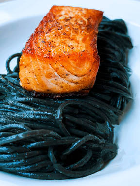 Crispy salmon and squid ink pasta