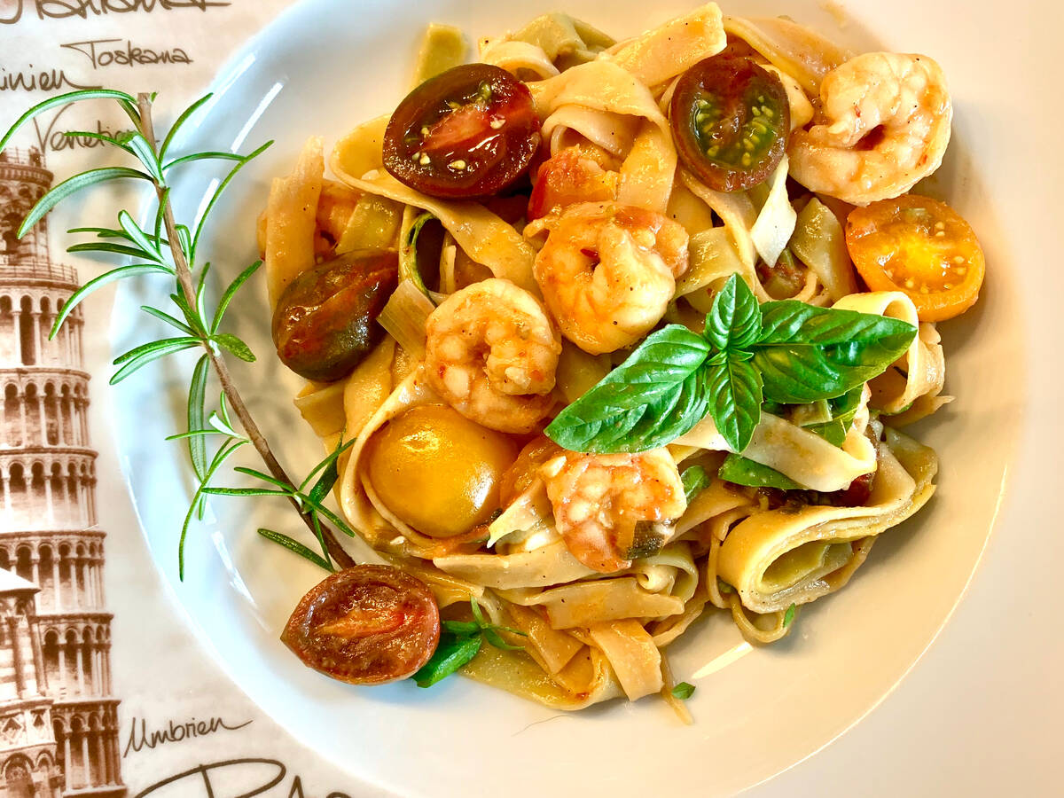 Tagliatelle with pan-fried shrimp and mixed cherry tomatoes