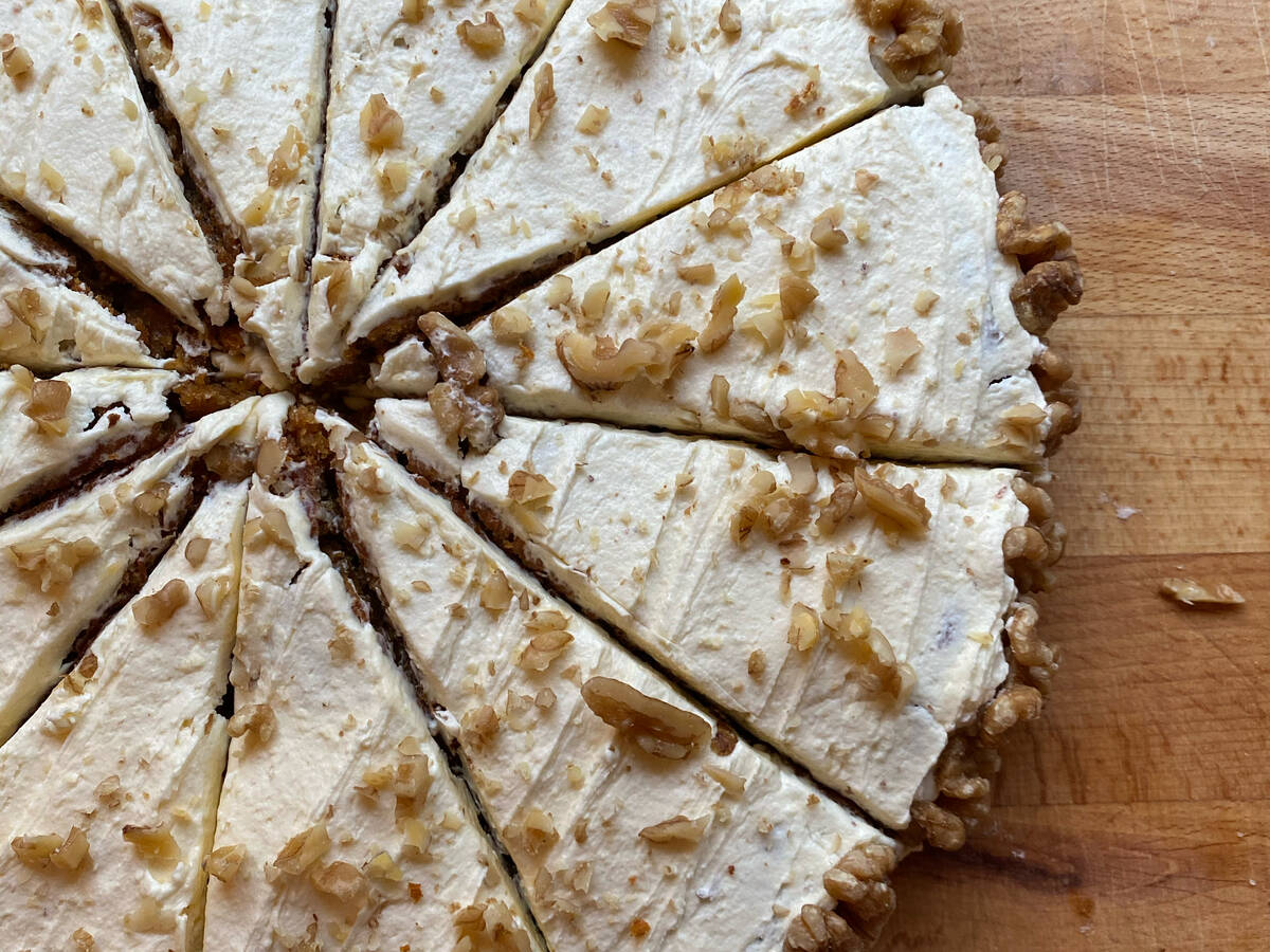 Vegan carrot cake with cream topping and walnuts