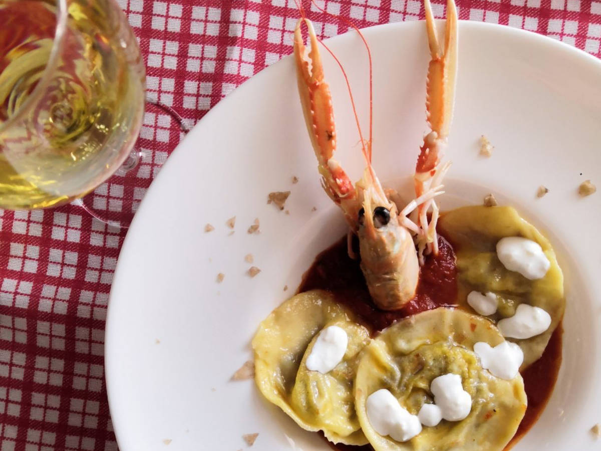 Pistachios and burrata ravioli with scampi sauce
