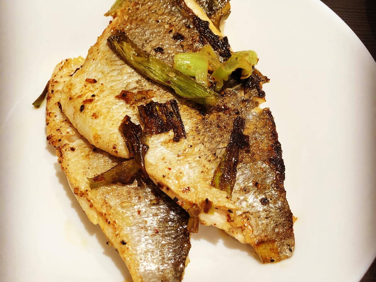 Pan fried crispy skinned sea bass filets