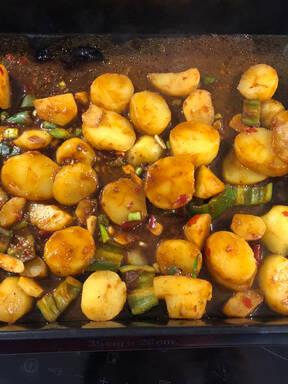 Roast curry golden potatoes