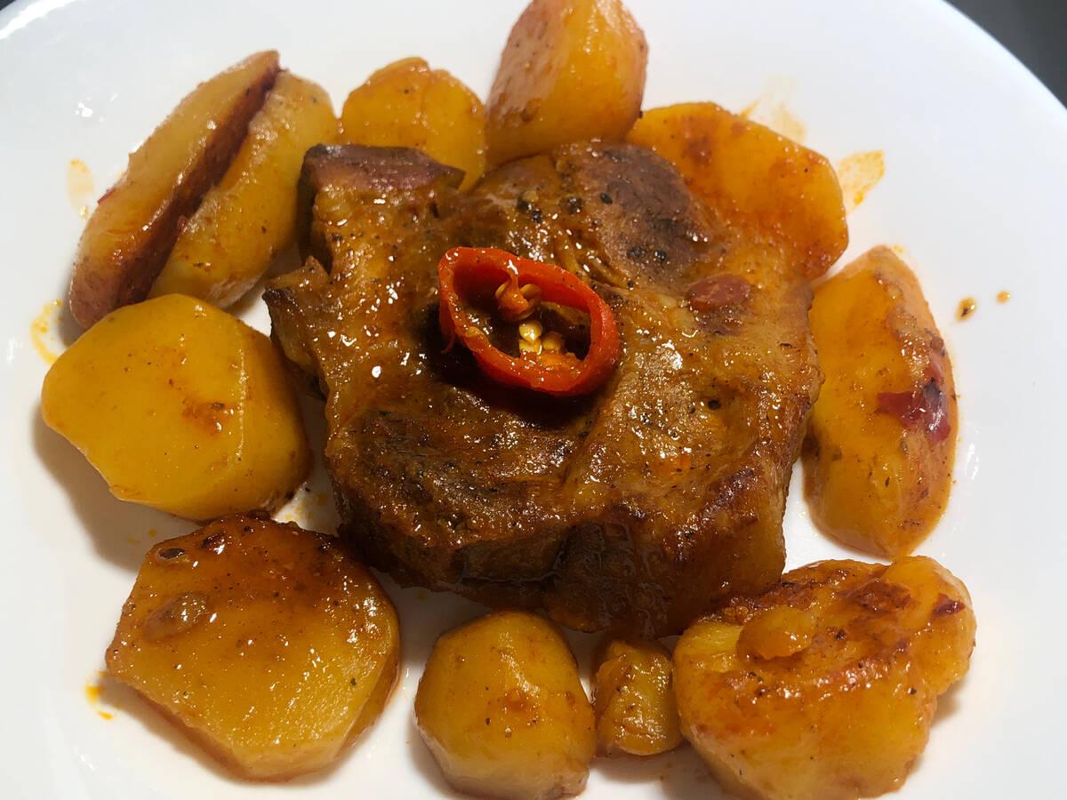 Oven roast pork shoulder with potatoes