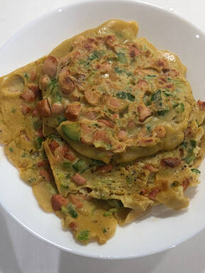 Chinese egg pancake with sausages and cucumber