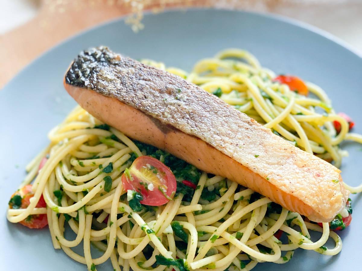 Crispy salmon with spinach aglio e olio