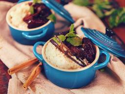 Rice pudding with baked plums