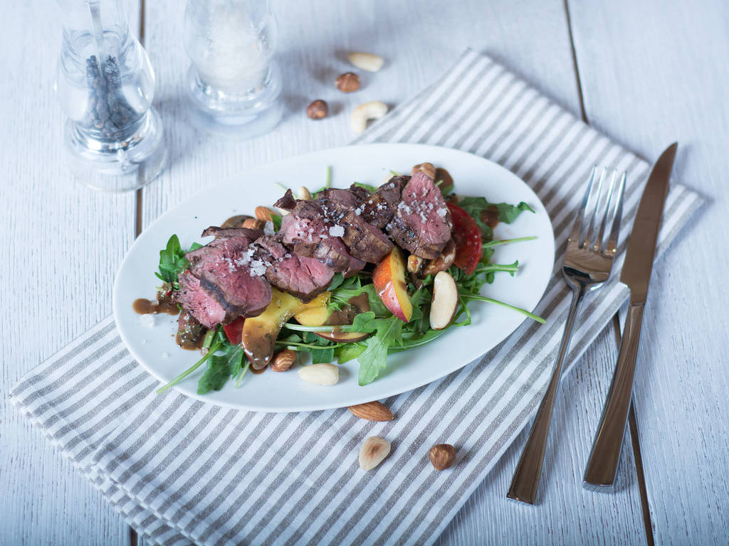 Summer salad with steak and nectarine