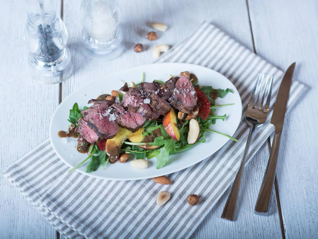 Summer salad with steak and nectarine