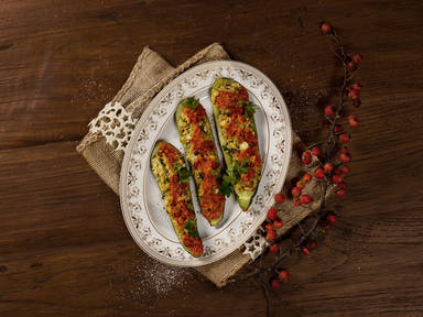 Baked zucchini with millet filling