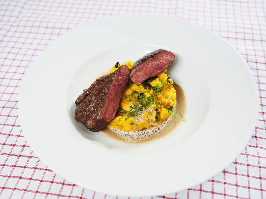 Venison with pumpkin sugo