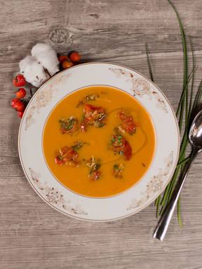 Sweet potato soup with chili tomatoes