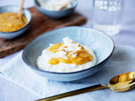 Coconut rice pudding with mango sauce