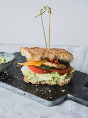 Spicy chicken sandwich with avocado cream