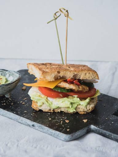 Spicy chicken sandwich with avocado cream