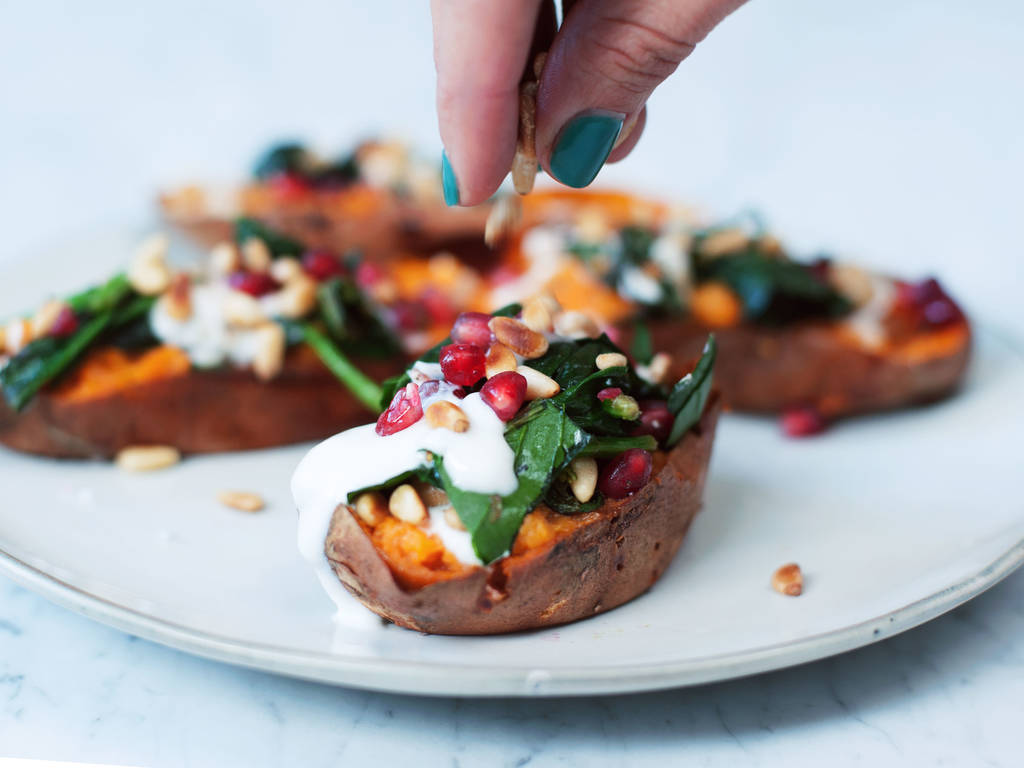 Baked sweet potatoes with spinach and pine nuts