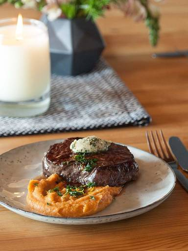 Sous vide steak with sweet potato purée and herb butter