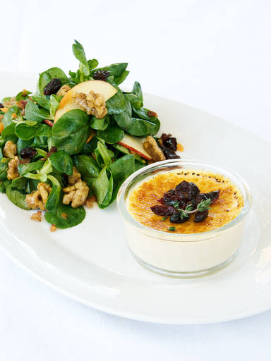 Goat cheese crème brûlée with lamb's lettuce and apple dressing