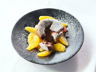 Molten chocolate cake and mulled wine citrus salad