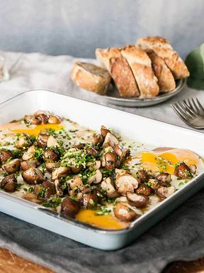 Baked eggs with caramelized mushrooms