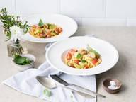 Tagliatelle mit Pancetta, Lauch und Tomaten