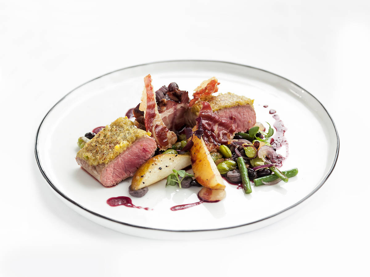 Pistachio-crusted lamb with pears, beans, and bacon