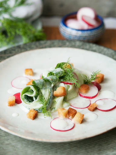 Creamy cucumber salad with radishes and croutons
