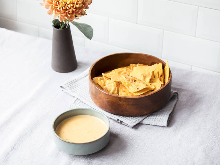 Baked tortilla chips with jalapeño-cheddar cheese dip