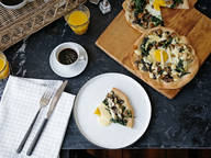 Breakfast pizza with mushrooms, spinach, and egg