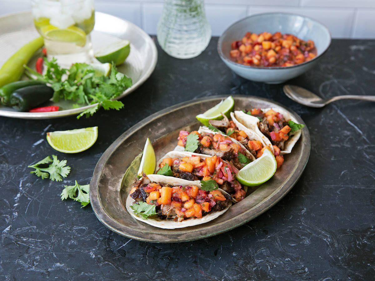 Pork carnitas tacos with peach salsa
