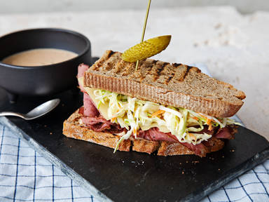 Reuben sandwich with pastrami and coleslaw