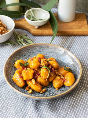 Pumpkin gnocchi with sage butter, walnuts, and smoked bacon