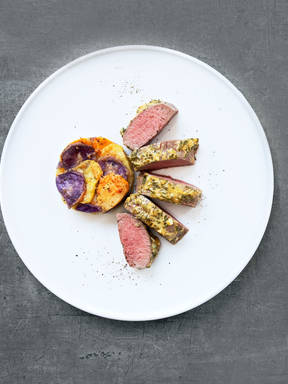 Oven-baked saddle of lamb with mustard-herb crust