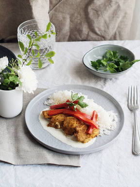 Chicken and bell pepper curry over rice