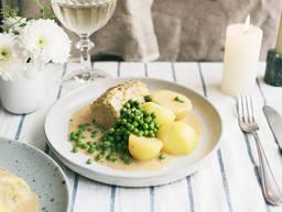 Pork tenderloin with potatoes and peas
