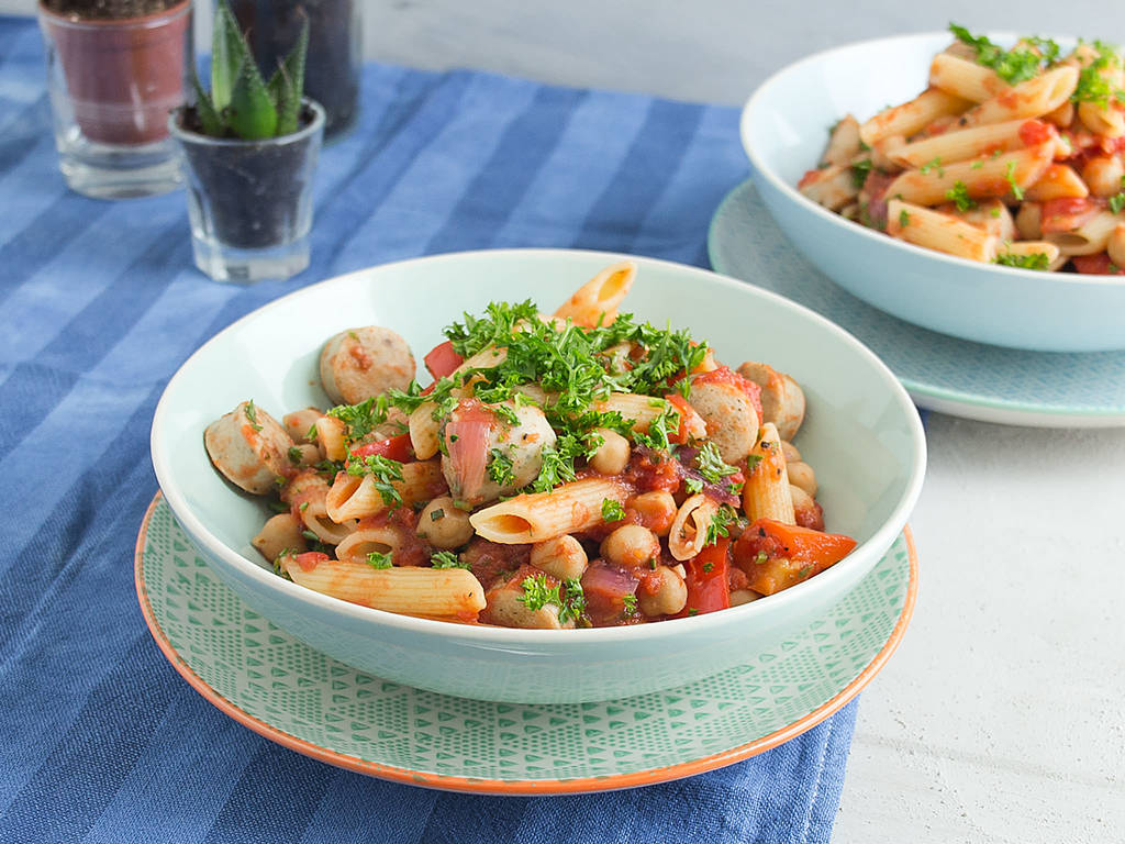 Pasta with sausage, tomatoes, and rosemary