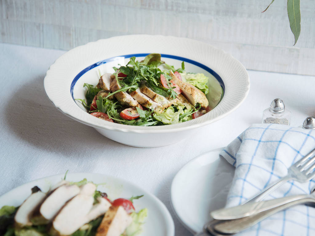 Green goddess buttermilk chicken over salad