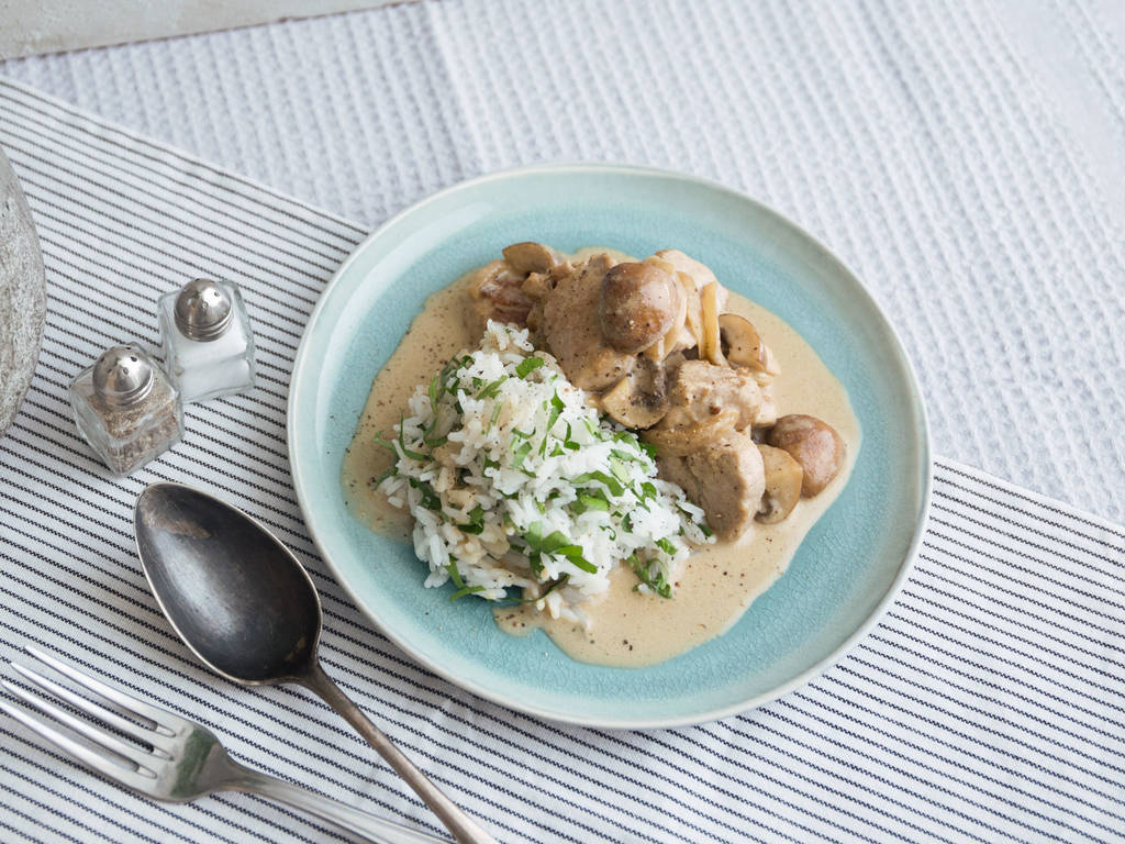 Creamy pork and mushroom ragout with rice