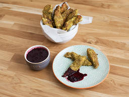 Pistachio-crusted chicken tenders with blackcurrant dip