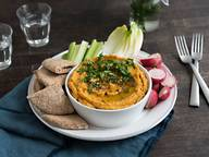 Carrot hummus with pita bread