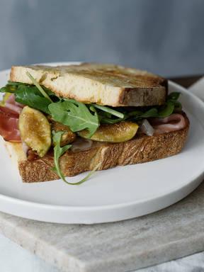 Caramelized fig, ham, and arugula sandwich