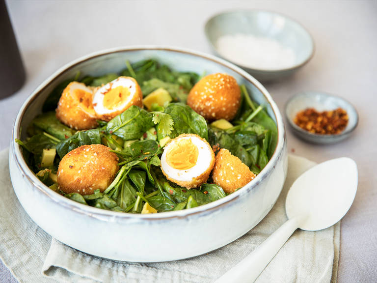 Crispy eggs with cilantro and avocado salad